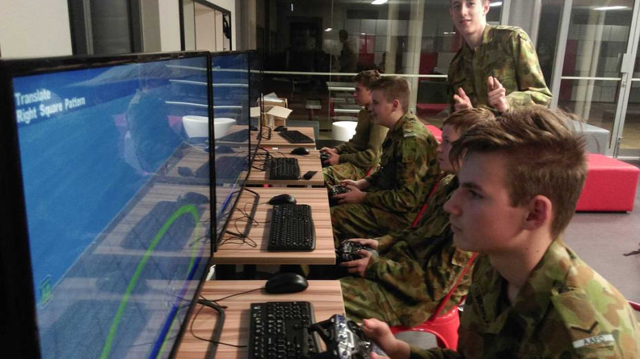 Australian Air Force Cadets at No 723 Squadron in Joondalup Western Australia give the 'thumbs up' while using their new AeroSIM-RC flight simulators.